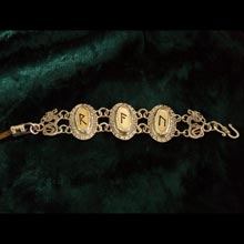 Amulets and Charms - Runes Bracelet Gold - Click here for more info